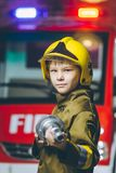Child Firefighter play. Station pretend fire car Stock Image