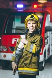 Child Firefighter play. Station pretend fire car Stock Photo