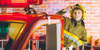 Child Firefighter play. Station pretend fire car Stock Photography