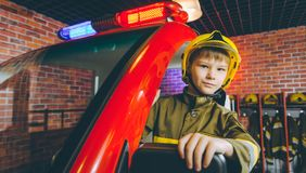 Child Firefighter play. Station pretend fire car Royalty Free Stock Photo