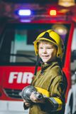 Child Firefighter play. Station pretend fire car Royalty Free Stock Images