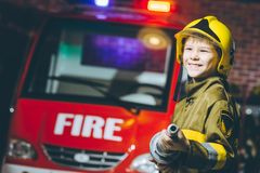 Child Firefighter play. Station pretend fire car Royalty Free Stock Photos