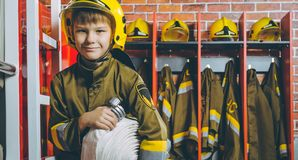 Child Firefighter play. Station pretend fire car Stock Images
