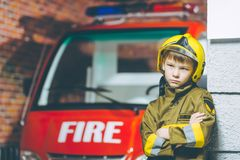 Child Firefighter play. Station pretend fire car Royalty Free Stock Photography