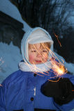 Child with firework. Child watching a cool firework royalty free stock photos