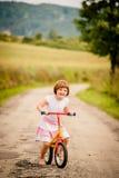 Child on firs bike Stock Image