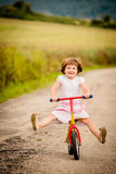 Child on firs bike Royalty Free Stock Photos