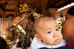 Child during the first ceremony for baby on Bali Stock Images