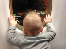 Child in front of plane window - First flight excitement Royalty Free Stock Images