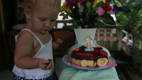 Child first saw cake for my birthday for a year with cherries with candle stock footage