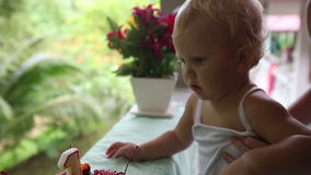 Child First Saw Cake for My Birthday for a Year with Cherries with Candle stock video footage