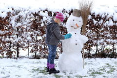 Child with first snow Royalty Free Stock Image