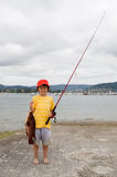 Child fisherman with red hat Stock Photography