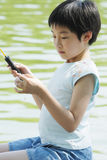 Child fishing Stock Images