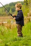 Child fishing. Young boy fishing at local pond Stock Images