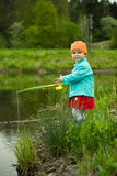Child is fishing. Funny little child is fishing Stock Image