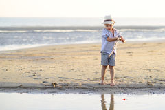 Child is fishing on the beach at the seaside. Child is fishing on the beach seaside Stock Image