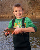 Child fishing - holding a Rainbow Trout stock photography