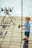 Child with fishing rod on wooden pier royalty free stock image