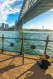 Child fishing in Sydney Harbour at sunset Stock Photos