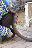 Child fixing bike or bicycle Royalty Free Stock Photo