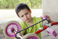 Child fixing and reparing Royalty Free Stock Images