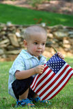 Child with Flag. Small boy holding the American Flag Stock Photo