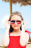 Child with a flag of America. Child in a red dress with a flag of America Stock Photo