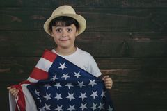 Child with the flag of the United States. 4th of July, Independence day stock images