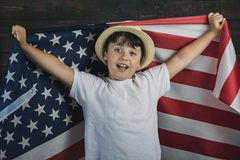 Child with the flag of the United States. 4th of July, Independence day stock photography
