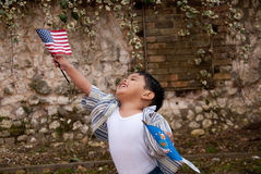 Child with flags. Young boy running free with USA flag Stock Images