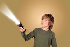 Child with a flashlight looking for something Royalty Free Stock Images