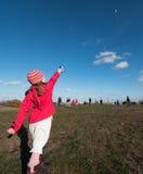 Child flies a kite Stock Image