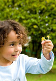 Child with a flower Stock Photo