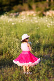 Child in a flower field Stock Photo