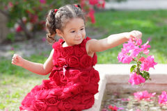 Child in a flower pattern dress Royalty Free Stock Photography