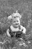 Child in a flower wreath Stock Images