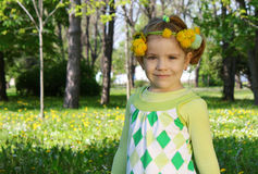 Child with flower wreath on head Stock Photography