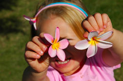 Child with flowers stock photo