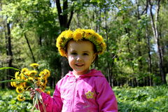 Child with flowers Royalty Free Stock Image