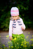 Child with flowers Royalty Free Stock Photo