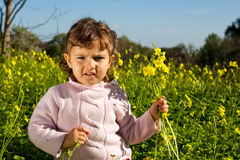 Child with flowers Royalty Free Stock Photos
