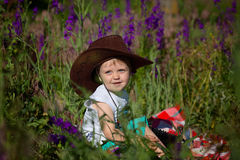 Child and Flowers Stock Image