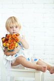Child with flowers Stock Images