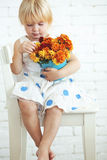 Child with flowers Royalty Free Stock Photography