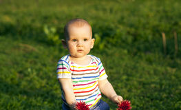 The child with flowers Stock Images