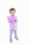 Child with Flowers. A young child holding pink flowers royalty free stock photo