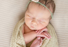 Child in flowery hairband sleeping wrapped, topview Stock Images