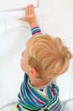 Child flushing the toilet Stock Image