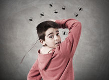 Child with fly swatter. Child with expression shooing flies Royalty Free Stock Photo